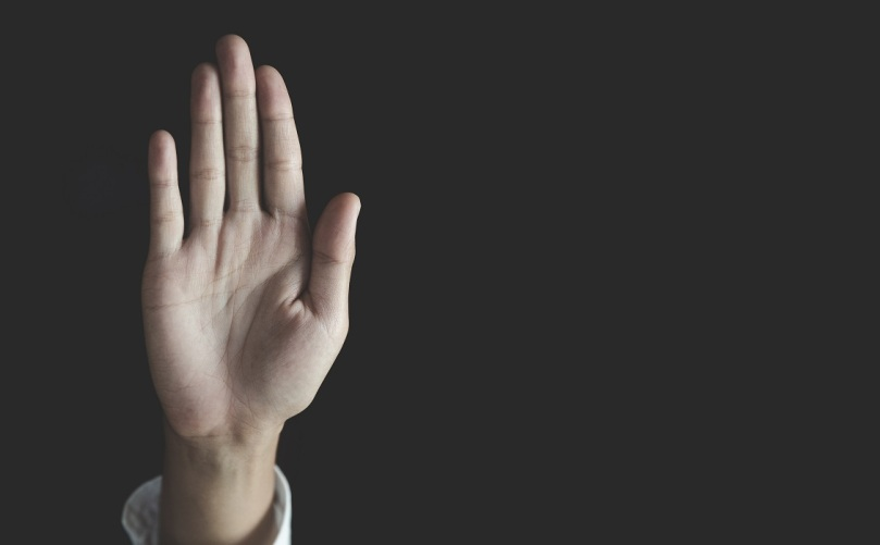 woman raised her hand for stopping sexual harassment
